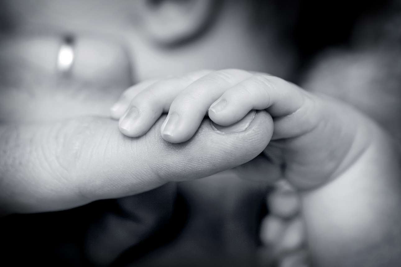 Clare J Sheridan Photography - Monochrome baby holoding parent's hand