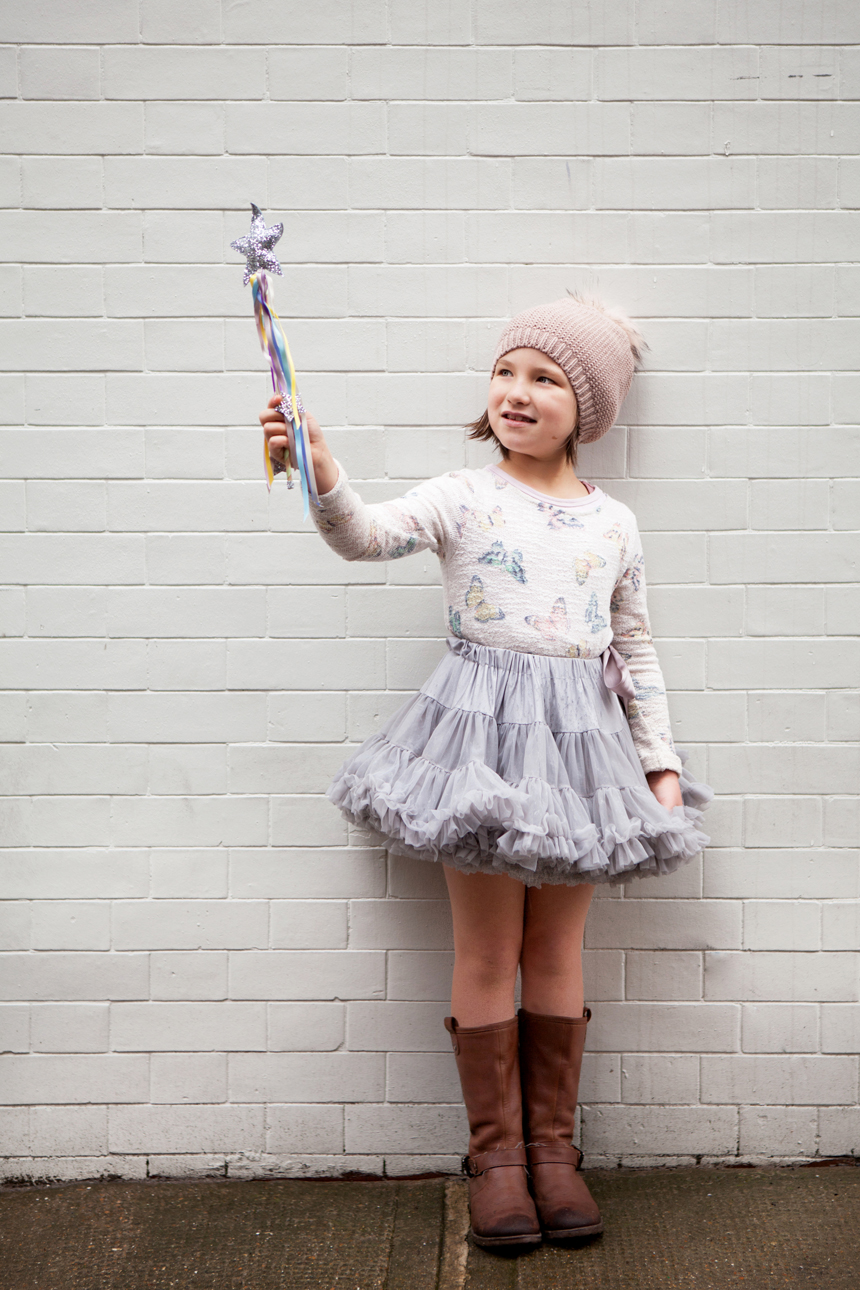 Clare J Sheridan Photography - Girl in tutu with woolly hat & wand