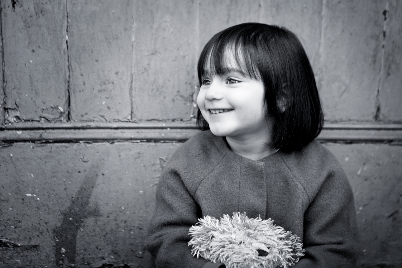 Clare J Sheridan Photography - Monochrome smiling girl with teddy bear