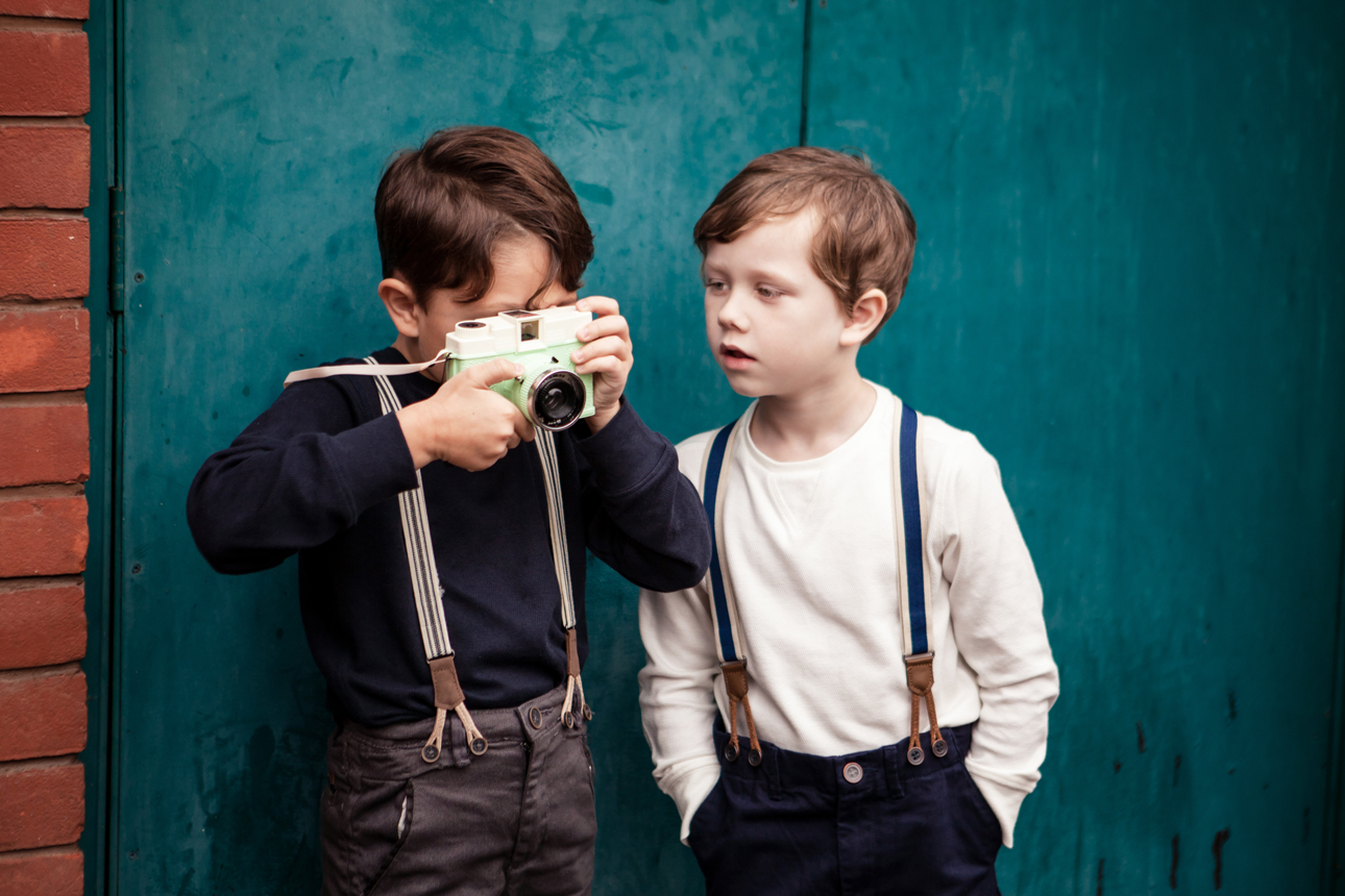 Clare J Sheridan Photography - Two boys play with toy camera