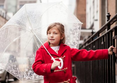Clare J Sheridan Photography - Girl in red coat with umbrella