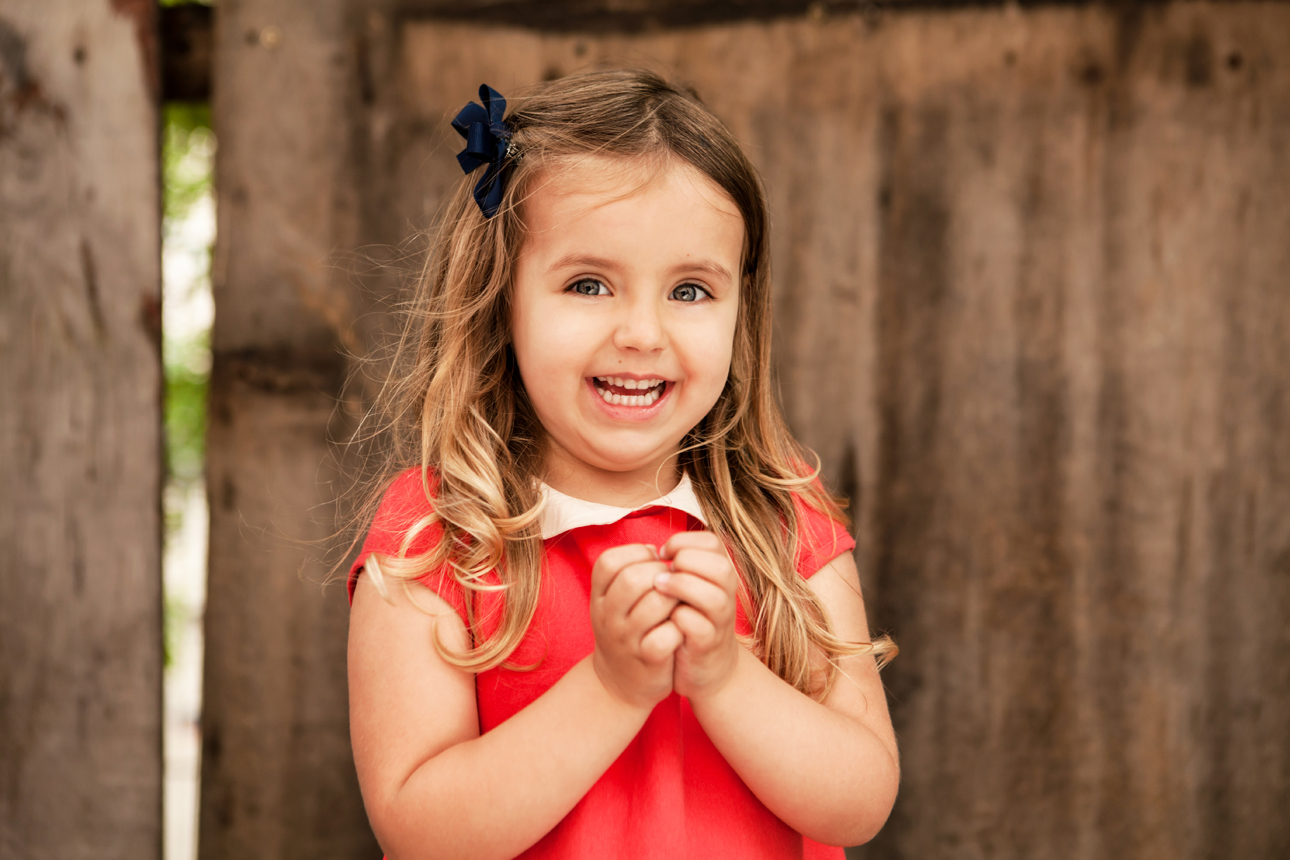 Clare J Sheridan Photography - Smiling girl in red dress