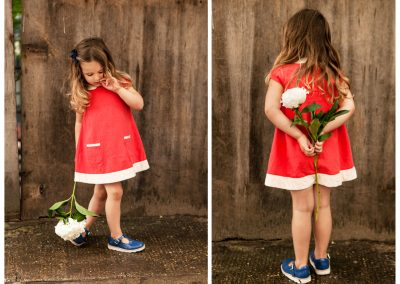 Clare J Sheridan Photography - Little girl in red dress holding white flower