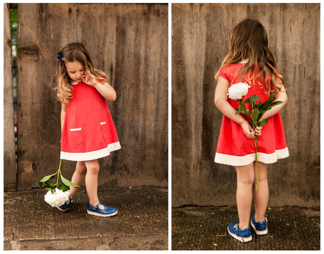 Clare J Sheridan Photography - Little girl in red dress holding white flower