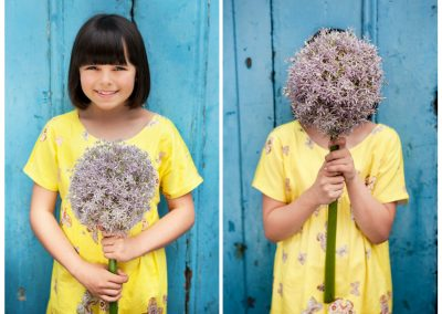 Clare J Sheridan Photography - Smiling girl in yeloow dress holding purple flower