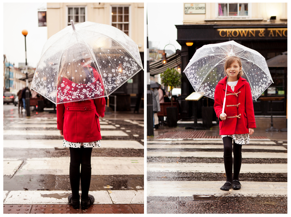 Clare J Sheridan Photography - Girl in red coat crossing road with umbrella