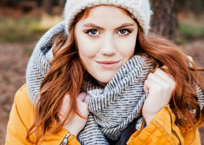 Clare J Sheridan Photography - Teenage girl in winter clothes in forest